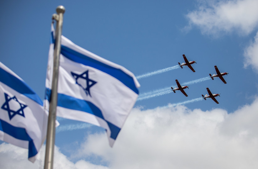 Israeli air force aerobatic team fly during a military training for the upcoming Israel's 73rd Independence day in Jerusalem, on April 12, 2021.  (photo credit: YONATAN SINDEL/FLASH 90)