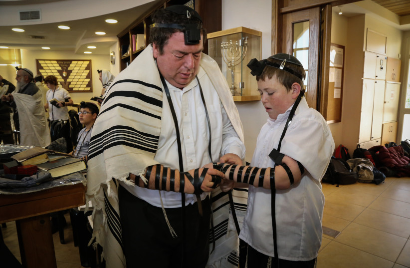 WOMEN ARE exempt from the time-bound mitzvah of tefillin (photo credit: GERSHON ELINSON/FLASH90)
