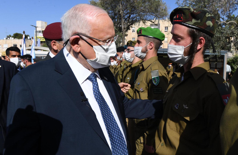 President Reuven Rivlin honors outstanding IDF soldiers at Independence Day ceremony on April 15, 2021. (photo credit: Mark Neiman/GPO)