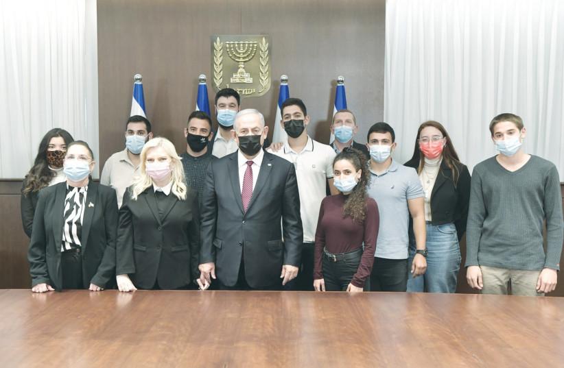 PRIME MINISTER Benjamin Netanyahu and his wife, Sara, with IDF orphans. (photo credit: KOBI GIDEON/GPO)