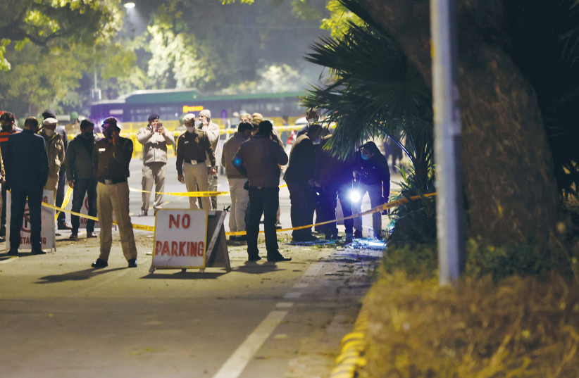 POLICE OFFICIALS examine the site of an explosion near the Israeli Embassy in New Delhi, in January. (photo credit: DANISH SIDDIQUI/ REUTERS)