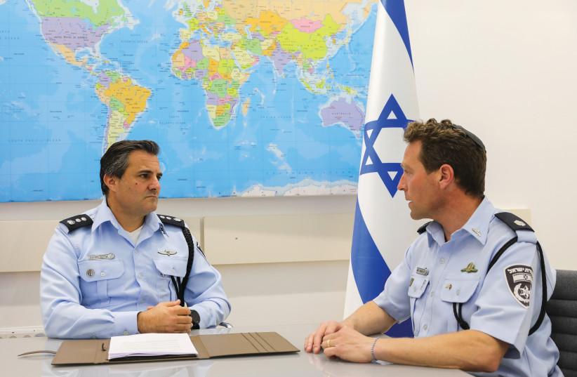 CMDR. Eliaz Haliva, head of the Israel Police International Cooperation Unit, with Supt. Micky Rosenfeld. (photo credit: MARC ISRAEL SELLEM/THE JERUSALEM POST)