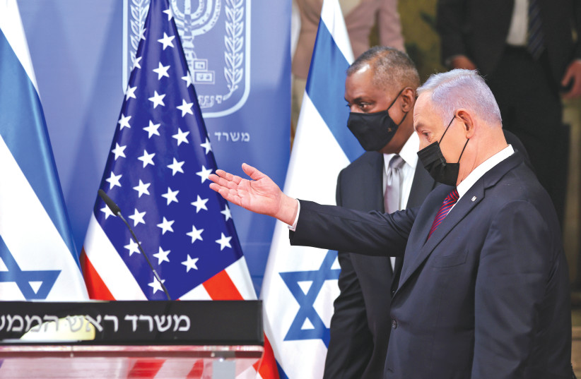 US DEFENSE SECRETARY Lloyd Austin and Prime Minister Benjamin Netanyahu arrive to give a statement after their meeting in Jerusalem on Monday. (photo credit: MENAHEM KAHANA / REUTERS)
