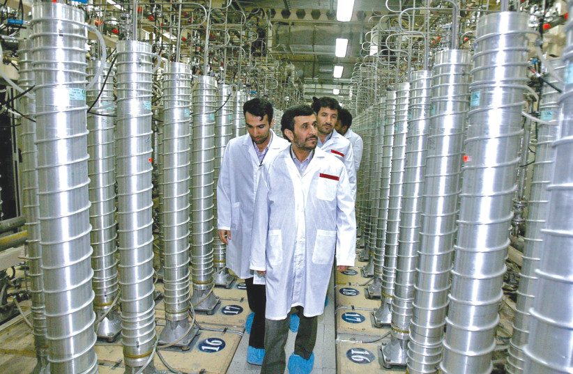 Former Iranian president Mahmoud Ahmadinejad visits the Natanz uranium enrichment facility in April 2008, shortly before its centrifuges were destroyed by the Stuxnet virus. Why is responsibility now being taken for attacks and involvement being admitted with bluster and bravado? (photo credit: PHOTO BY THE OFFICE OF THE PRESIDENCY OF THE ISLAMIC REPUBLIC OF IRAN VIA GETTY IMAGES)