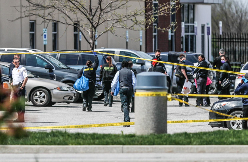 Investigators are on the scene following a mass shooting at a FedEx facility in Indianapolis, Indiana, U.S., April 16, 2021. (photo credit: MICHELLE PEMBERTON-USA TODAY NETWORK VIA REUTERS)
