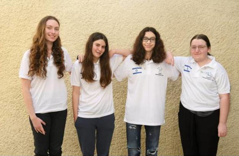 The Israeli delegation for the 2021 European Girls Mathematical Olympiad (EGMO) stands together after the competition. Left to right: Nicole Grossman, Noga Friedman, Tamar Pe'er and Ya'ara Shulman (photo credit: FUTURE SCIENTISTS CENTER)