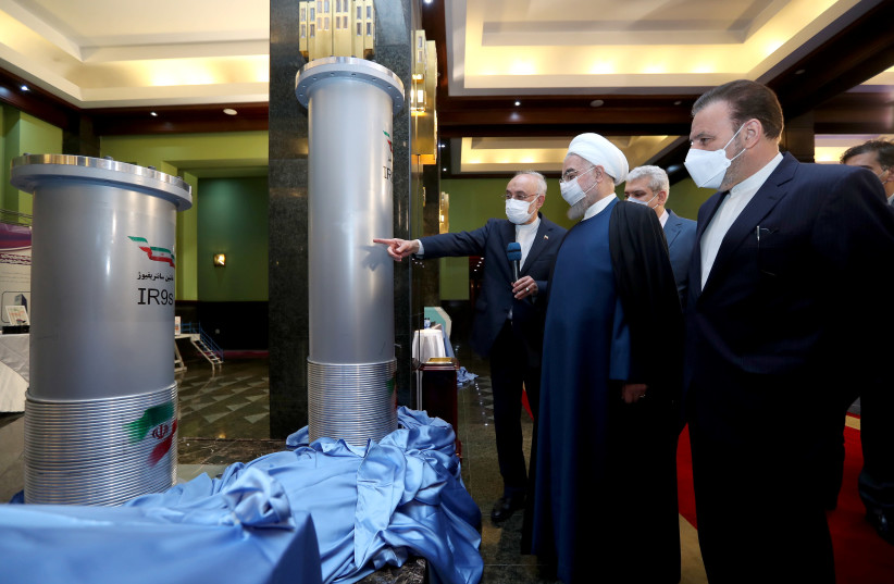 Iranian President Hassan Rouhani reviews Iran's new nuclear achievements during Iran's National Nuclear Energy Day in Tehran, Iran April 10, 2021. (photo credit: IRANIAN PRESIDENCY OFFICE/WANA (WEST ASIA NEWS AGENCY)/HANDOUT VIA REUTERS)