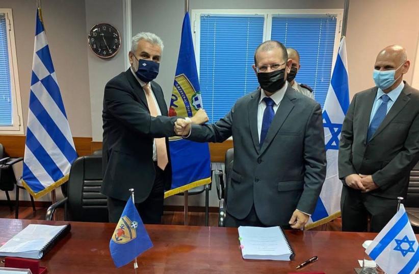 Israel, Greece sign their largest defense procurement agreement, April 18 2021  (photo credit: GREEK DEFENSE MINISTRY)