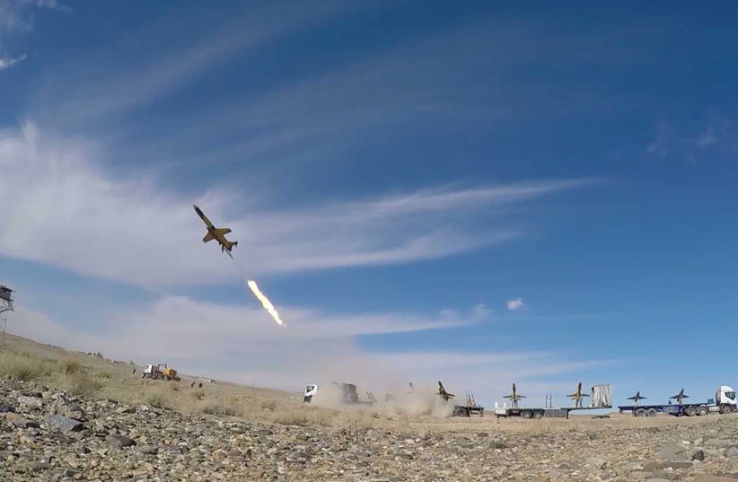 A drone is launched during a large-scale drone combat exercise of Army of the Islamic Republic of Iran, in Semnan, Iran January 6, 2021 (photo credit: IRANIAN ARMY/WANA/REUTERS)