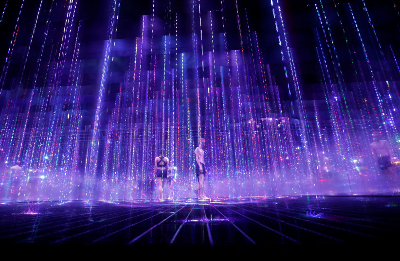 Demonstration of TikTok teamLab Reconnect, digital artwork combined with sauna, ahead of its opening to the public this month in TokyoDemonstration of TikTok teamLab Reconnect, digital artwork combined with sauna, ahead of its opening to the public this month in Tokyo (photo credit: REUTERS)
