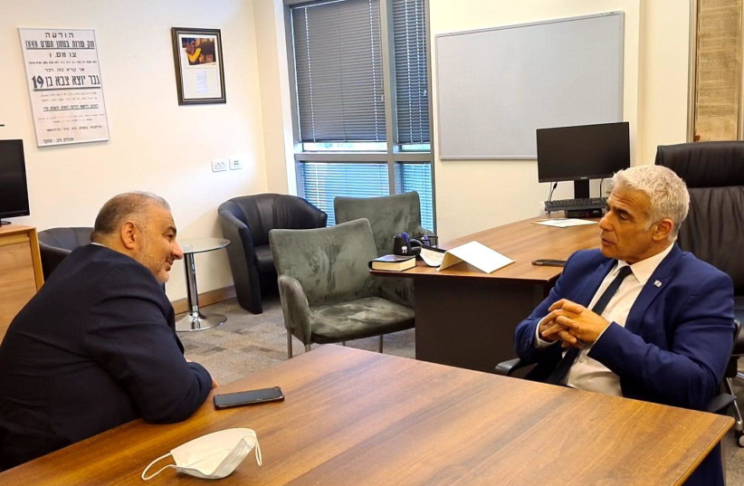 Ra'am Party leader Mansour Abbas is seen meeting with Yesh Atid leader Yair Lapid. (photo credit: COURTESY YESH ATID)