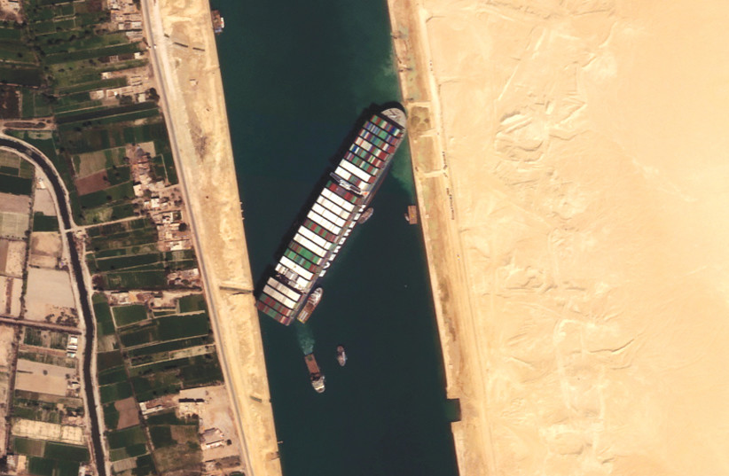 THE 'EVER GIVEN' container ship is seen in the Suez Canal in this satellite image taken by Satellogic's NewSat-16 last month. (photo credit: SATELLOGIC/REUTERS)