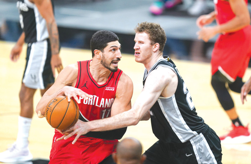 PORTLAND TRAIL Blazers center Enes Kanter (11) drives toward the basket against San Antonio Spurs center Jakob Poeltl in a game at the AT&T Center in San Antonio, Texas, earlier this week. (photo credit: DANIEL DUNN/USA TODAY SPORTS/REUTERS)