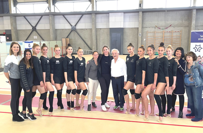 THE ISRAEL RHYTHMIC GYMNASTICS TEAM poses with Adv. Inbar Nacht, President of Nacht Philanthropic Ventures, which is a new sponsor of the team in its quest for an Olympic medal in Tokyo. (photo credit: Courtesy)
