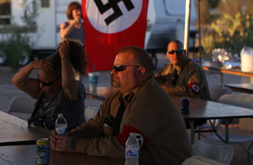 Burt Colucci of the white nationalist group National Socialist Movement attends a rally in Maricopa, Arizona, U.S., April 16, 2021. (photo credit: JIM URQUHART/REUTERS)