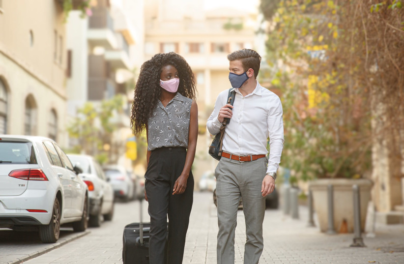 People can be seen wearing Sonovia's SonoMask. (photo credit: COURTESY OF SONOVIA)