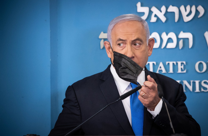 Israeli prime minister Benjamin Netanyahu gives a press conference with Health minister Yuli Edelstein (unseen) at the Prime Minister's office in Jerusalem, on April 20, 2021.21 (photo credit: YONATAN SINDEL/FLASH 90)