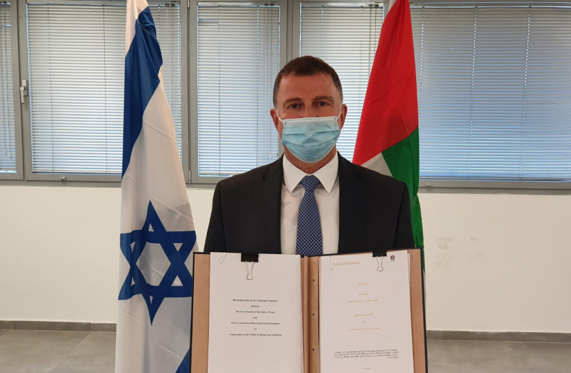 Health Minister Yuli Edelstein is seen with a signed agreement with the UAE for medical cooperation. (photo credit: HEALTH MINISTRY)