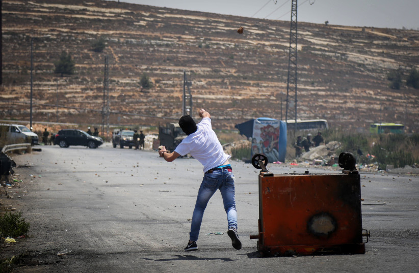 Students from the University of Birzeit clash with Israeli security forces (unseen) near the West Bank city of Ramallah, on July 24, 2017.  (photo credit: FLASH90)
