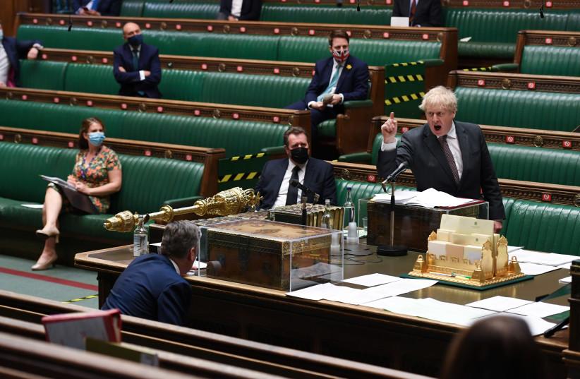 Britain's Prime Minister Boris Johnson speaks during Prime Minister's Questions session in London, Britain April 21, 2021.  (photo credit: UK PARLIAMENT/JESSICA TAYLOR/HANDOUT VIA REUTERS)