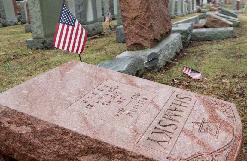 TOPPLED JEWISH headstones – 170 in total – vandalized in Chesed Shel Emeth Cemetery in St. Louis, Missouri, back in 2017 (photo credit: REUTERS/TOM GANNAM)