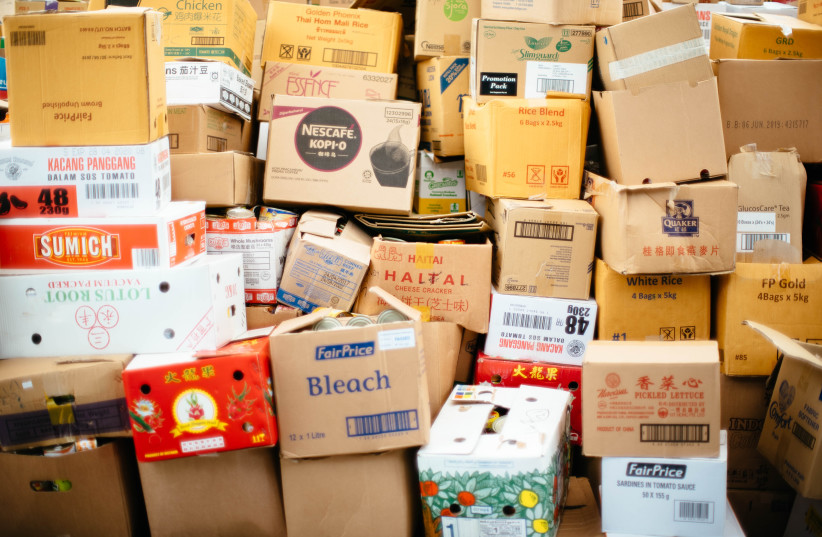 I ENDED up minimizing from the 31 boxes stashed in my childhood closet, Illustrative (photo credit: CHUTTERSNAP/UNSPLASH)