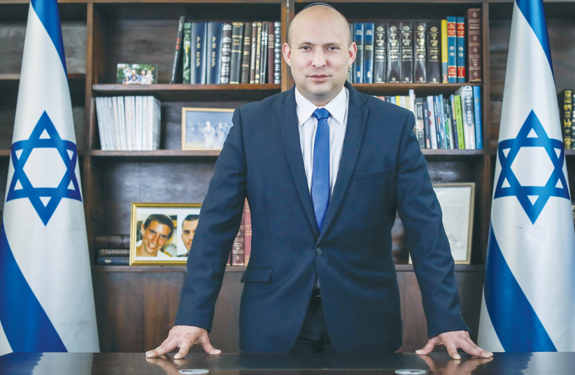 NAFTALI BENNETT in his office. The Yamina Party leader now represents the sane right wing in the political arena. (photo credit: MARC ISRAEL SELLEM/THE JERUSALEM POST)
