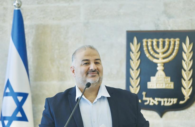 UNITED ARAB LIST leader Mansour Abbas addresses the Knesset earlier this week. (photo credit: MARC ISRAEL SELLEM/THE JERUSALEM POST)