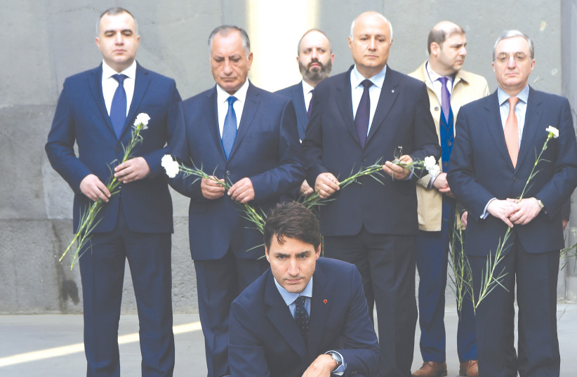 CANADIAN PRIME MINISTER Justin Trudeau takes part in a wreath-laying ceremony at the Tsitsernakaberd Armenian Genocide Memorial in Yerevan in 2018. Will an Israeli leader do the same one day? (photo credit: MELIK BAGHDASARYAN/REUTERS)
