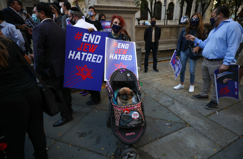 A crowd protests anti-Semitism in New York City, Oct. 15, 2020. (photo credit: TAYFUN COSKUN/ANADOLU AGENCY VIA GETTY IMAGES)