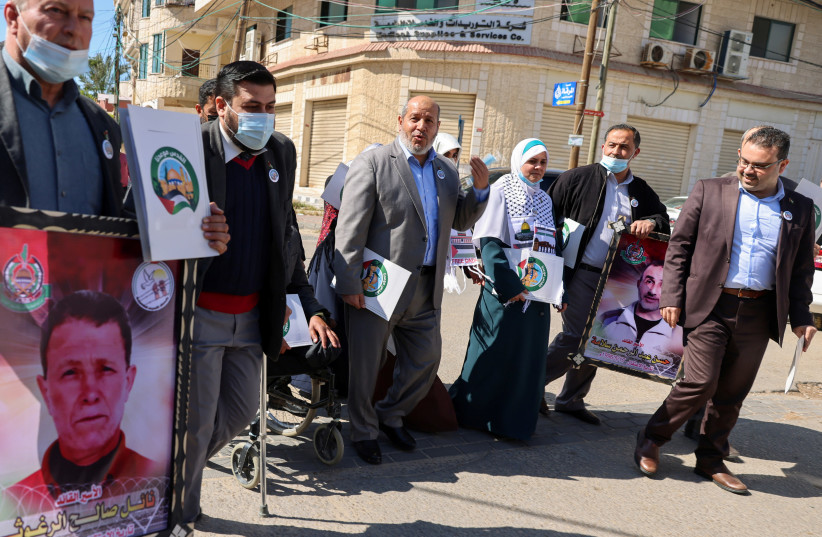 Khalil al-Hayya, Hamas's deputy leader in Gaza, arrives with other representatives to register Hamas's list for the upcoming parliamentary elections, in Gaza City March 29, 2021. Picture taken March 29, 2021. (photo credit: REUTERS/MOHAMMED SALEM)
