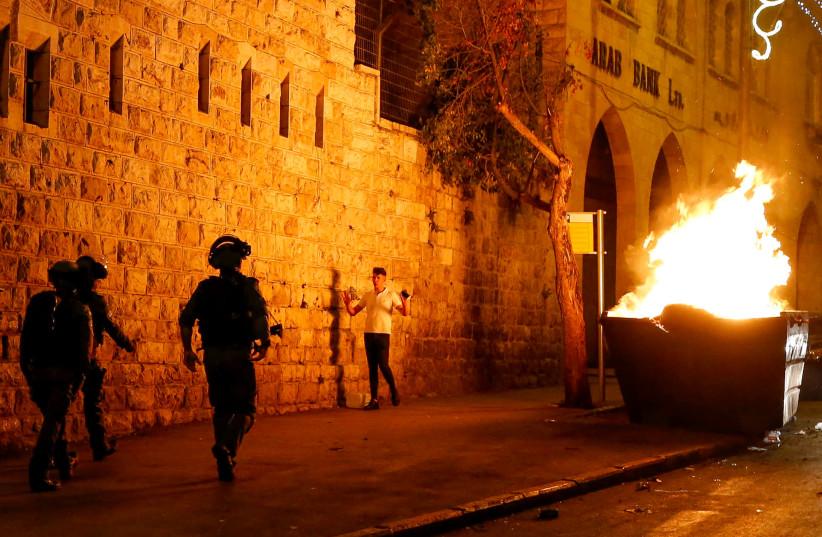 Israeli police officers clash with arabs in East Jerusalem on April 23, 2021 (photo credit: JAMAL AWAD/FLASH90)