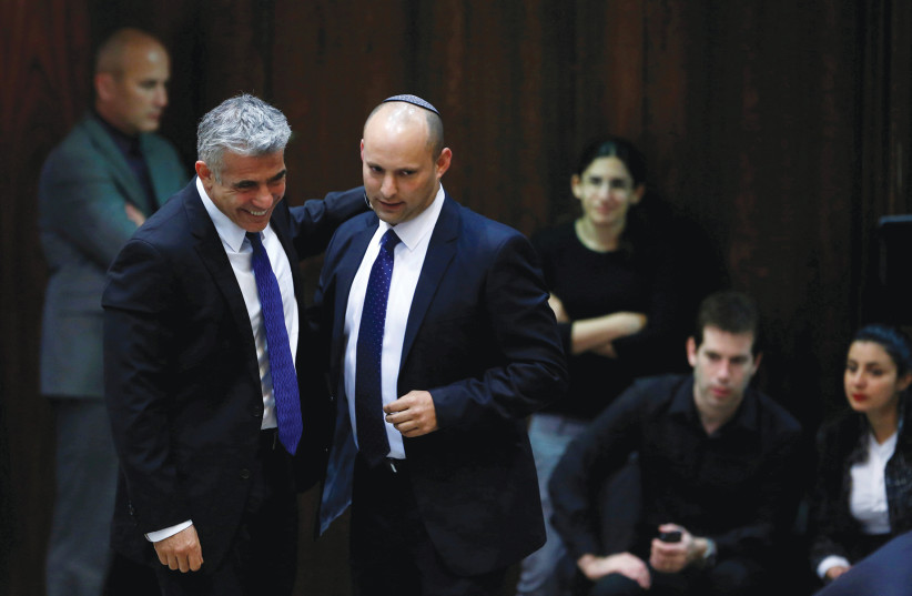 YAIR LAPID (left) and Naftali Bennett share a smile at the Knesset in 2013. (photo credit: BAZ RATNER/REUTERS)