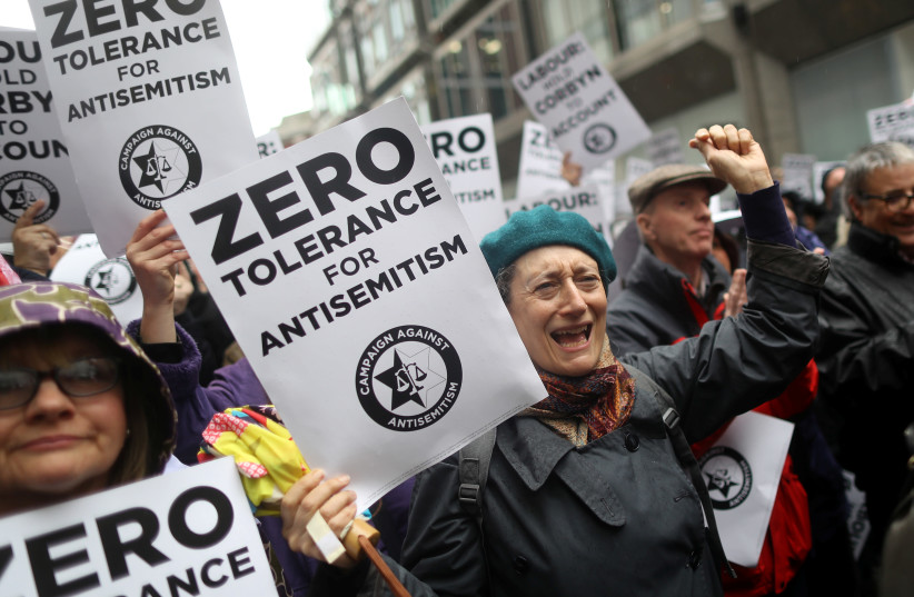 Demonstrators take part in an antisemitism protest outside the Labour Party headquarters in central London, Britain April 8, 2018. (photo credit: REUTERS/SIMON DAWSON)