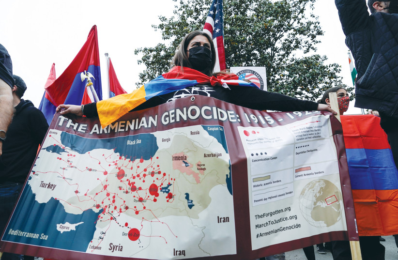 MEMBERS OF the Armenian diaspora rally in front of the Turkish Embassy after US President Joe Biden recognized that the 1915 massacres of Armenians in the Ottoman Empire constituted genocide, in Washington last week. (photo credit: JOSHUA ROBERTS / REUTERS)