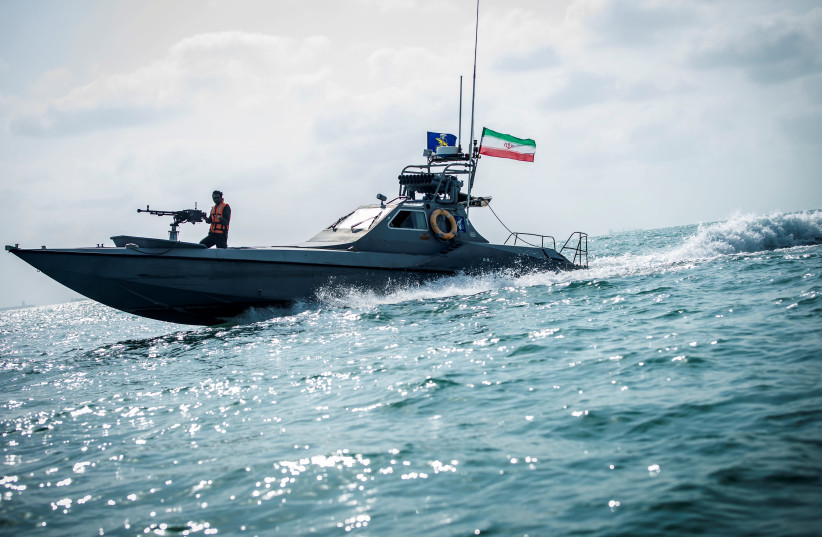 A boat of the Iranian Revolutionary Guard (IRGC) sails, at undisclosed place off the coast of Bandar Abbas, Iran August 22, 2019. (photo credit: NAZANIN TABATABAEE/WANA VIA REUTERS)
