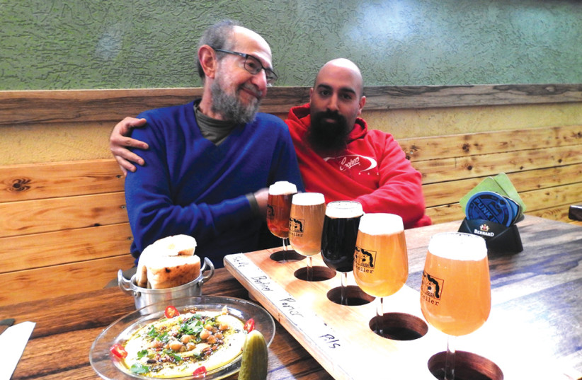 THE WRITER with Shmuel 'Shmultz' Naky, partner and chief brewer, at Beerateinu. (photo credit: MIKE HORTON)