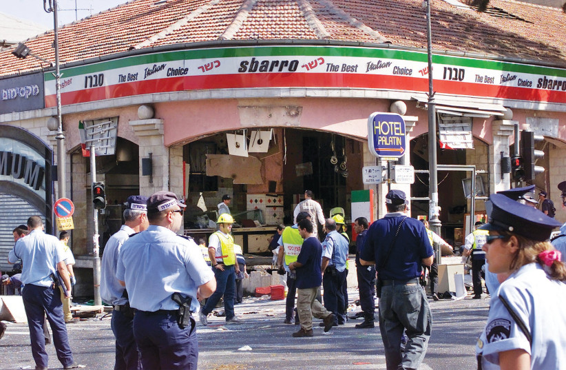 A GAPING hole is left in the shop front of the Sbarro pizzeria in Jerusalem after the suicide bombing that killed 15 people and wounded more than 80 others. (photo credit: REUTERS)
