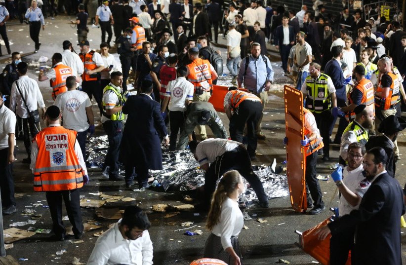 Israeli rescue forces and police near the scene after a stampede killed dozens during the celebrations of the Jewish holiday of Lag Baomer on Mt. Meron, in northern Israel on April 30, 2021 (photo credit: DAVID COHEN/FLASH 90)