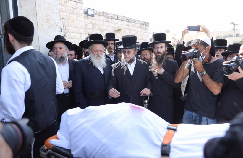 The funeral of a victim of the Mount Meron tragedy that took place on Lag B'Omer, April 2021. (photo credit: MARC ISRAEL SELLEM/THE JERUSALEM POST)