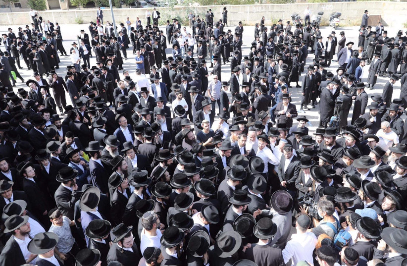 Mourners attend the funeral of one of the victims of the Meron stampede that took place on Lag Ba'omer. (photo credit: MARC ISRAEL SELLEM)