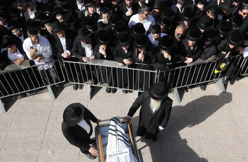Mourners gather at a funeral for one of the victims of the 45 deceased of the Mount Meron tragedy, Lag Ba'omer, 2021. (photo credit: MARC ISRAEL SELLEM/THE JERUSALEM POST)