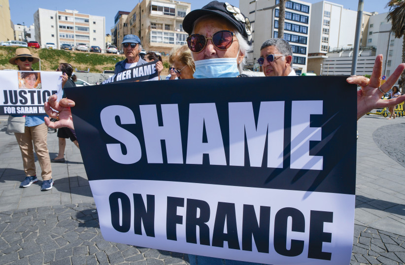 PROTESTORS GATHER outside the French Embassy in Tel Aviv on Sunday to demand justice for Sarah Halimi, who was murdered by an antisemitic assailant in her apartment in Paris in 2017. (photo credit: AVSHALOM SASSONI/FLASH90)