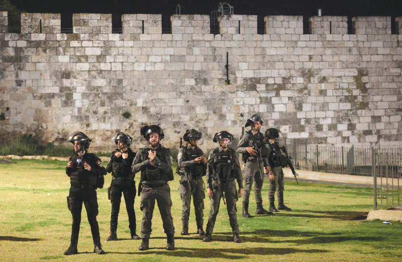 POLICE OFFICERS stand by the walls of Jerusalem's Old City amid tension with Palestinians during Ramadan earlier this week. (photo credit: RONEN ZVULUN / REUTERS)