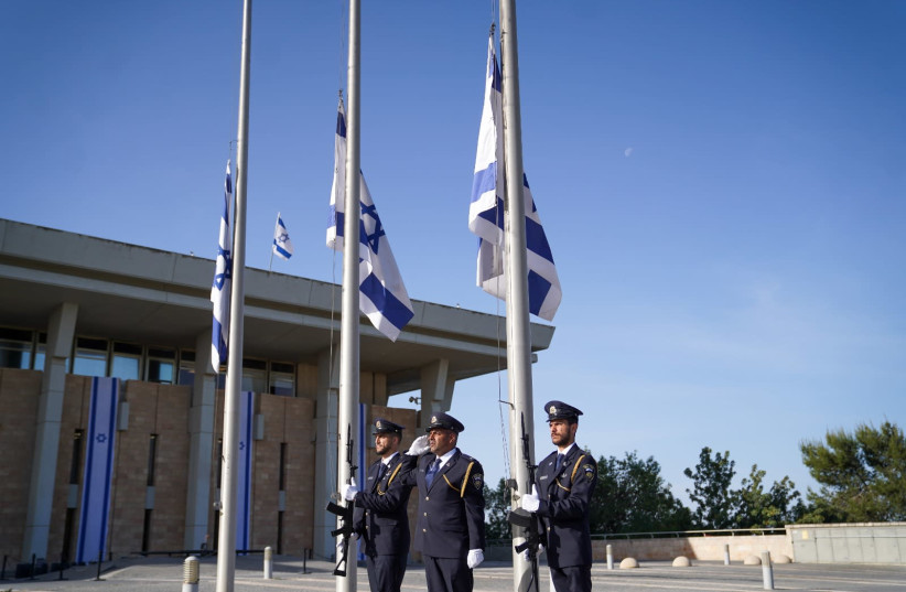 Flags at the Knesset were lowered to half mast in memory of the victims of the Meron disaster in a special ceremony at the Knesset on Sunday morning. (photo credit: NOAM MOSKOVICH)