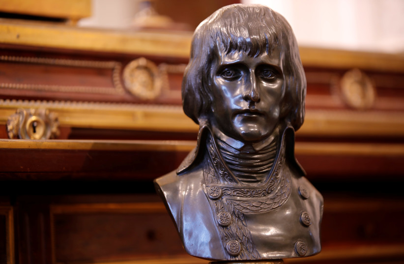 "A bronze bust named ""The First Consul Bonaparte"" according to Louis-Simon Boizot (1743-1809) is displayed at Osenat auction house, before being put on auction for the bicentenary of Napoleon's death, in Fontainebleau, near Paris, France, April 30, 2021 (photo credit: REUTERS/SARAH MEYSSONNIER)"