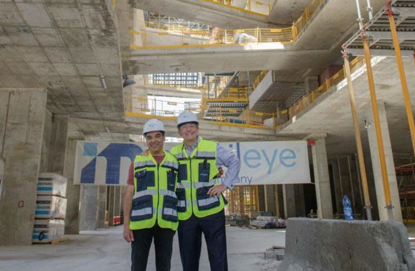Mobileye CEO Amnon Shashua welcomes Intel CEO Pat Gelsinger to the site of Mobileye's new headquarters building In Jerusalem. (photo credit: Courtesy)