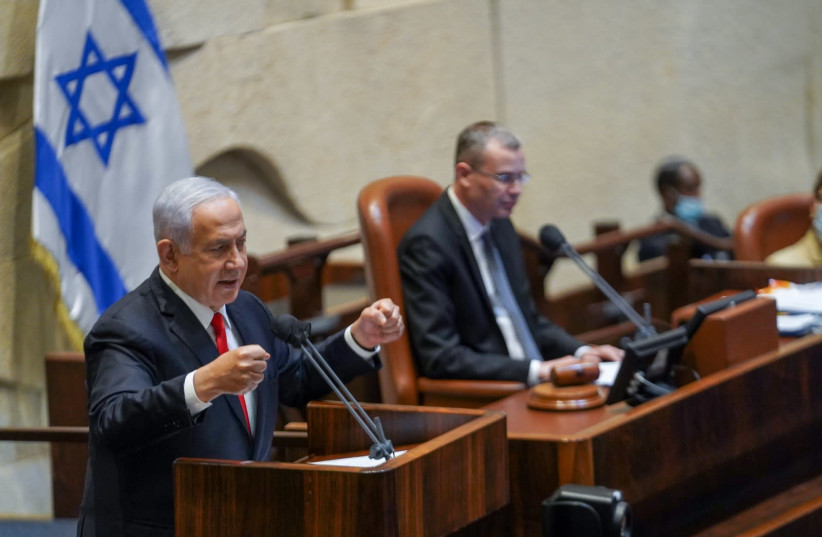 Prime Minister Benjamin Netanyahu is seen addressing the Knesset on May 3, 2021. (photo credit: DANI SHEM TOV/KNESSET SPOKESPERSONS OFFICE)