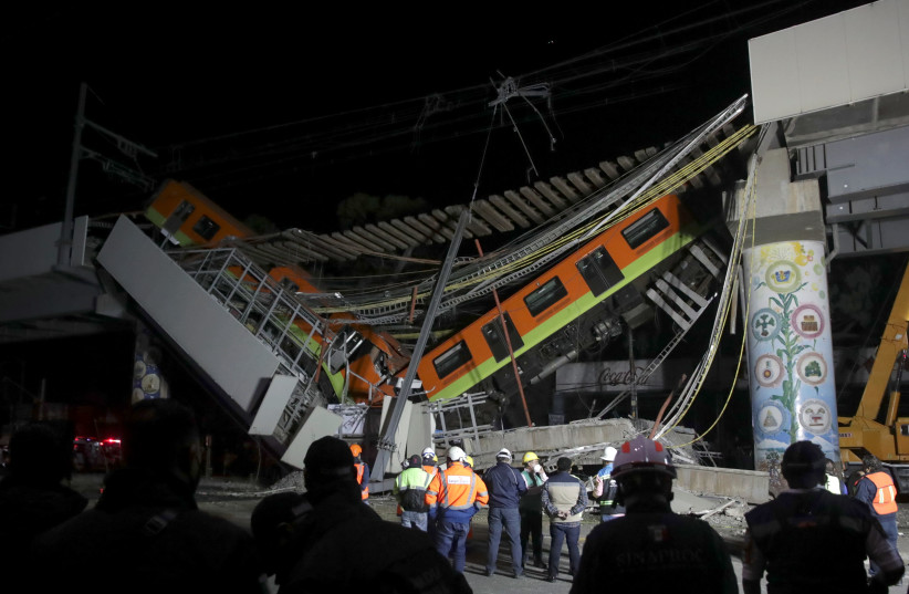 The site where an overpass for a metro partially collapsed with train cars on it is seen at Olivos station in Mexico City, Mexico, May 4, 2021 (photo credit: REUTERS/HENRY ROMERO)