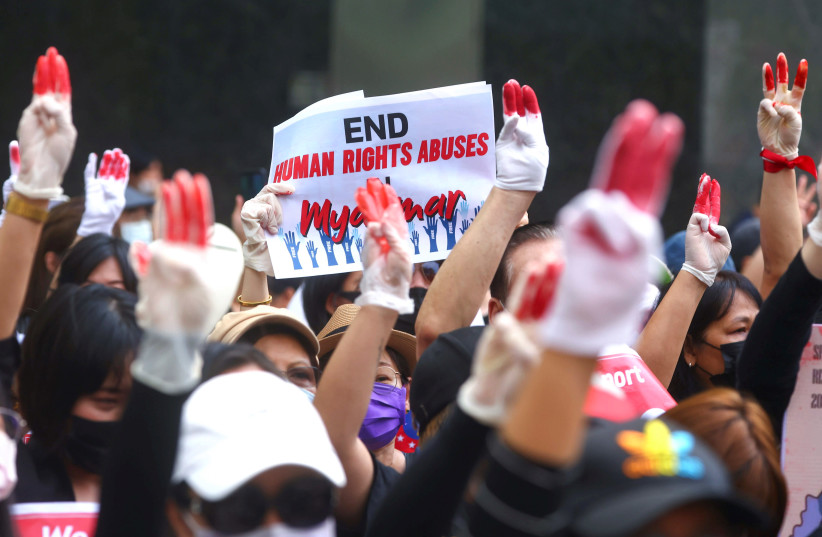 Protesters flash a three-finger salute during a march to protest against Myanmar military coup, in Taipei (photo credit: ANN WANG / REUTERS)